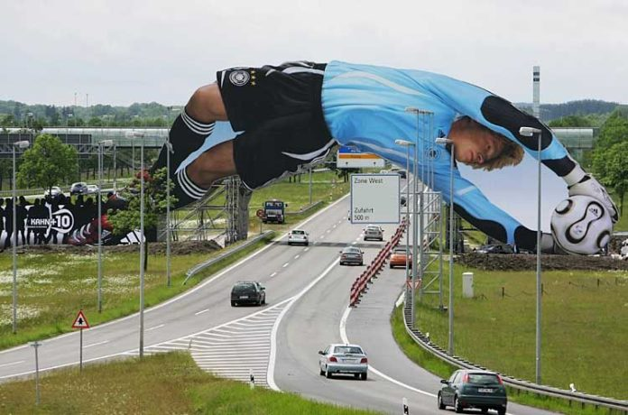 MUNICH, GERMANY - MAY 28:  A giant poster of German National Goalkeeper Oliver Kahn is unveiled at the Munich Airport on May 27, 2006 in Munich, Germany. The 65 meter long poster is part of an adidas campagne and will be installed for the duration of the Worls Cup 2006.  (Photo by Sandra Behne/Bongarts/Getty Images)