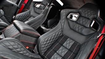 Land Rover Defender tweed-kosztümben