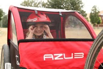 Ülés és utánfutó: gyermekszállítás kerékpáron