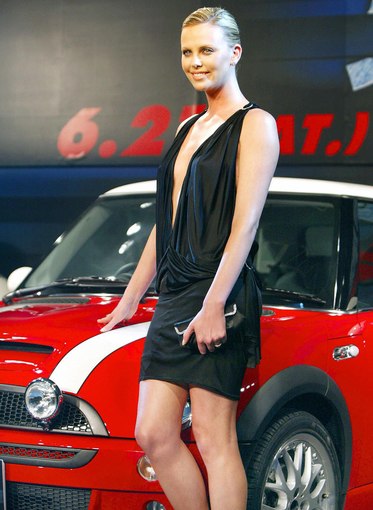 Charlize-wore-sexy-black-minidress-she-posed-Mini-Cooper