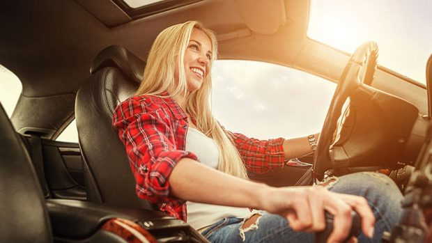 42564002 - young woman drive a car