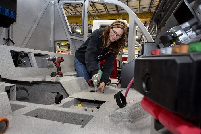 Tracy Munden, assembling cab of vehicle in Neenah, Wisconsin, U