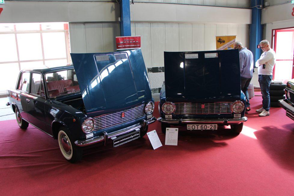 """FIAT 124 Berlina - Második gazdás RAvenna mellől, 170 000 kilométer van benne. Ez a típus az """"Ős Lada"""", az Év Autója volt 1967-ben. VAZ 2101 - 1972-es a gyártás krai szakaszára, az első szériára jellemz őmegodlásokkal. Feltűnő a fehér indexbúra, és a sárvédőre rögzítettt körtükör. A lökhárítókat nagyméretű ütközőbakkal szerelték, az utastérben pedig sűrűbordás műszerfal, szürke keretes visszapillantó tükör, és álló gázpedál található."""