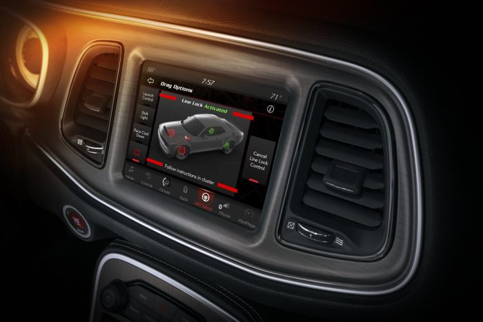 The 2018 Dodge Challenger SRT Demon offers line lock, a feature that assists the driver in preventing forward vehicle movement during a burnout through enhanced control of the brakes while revving the engine to its peak power RPM, as shown on the 8.4-inch Uconnect touchscreen.