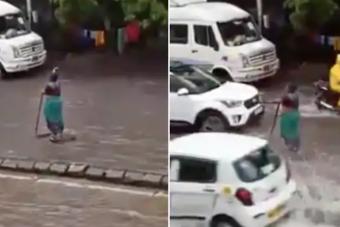 Öt órán át állt az elárasztott, veszélyes úton egy nő, és figyelmezette a közlekedőket