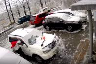 Ítéletidő Oroszországban: több centis jégpáncél az autókon, összeomlott közlekedés 1